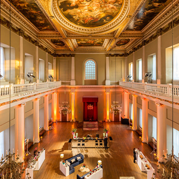 Banqueting House with amber uplighting