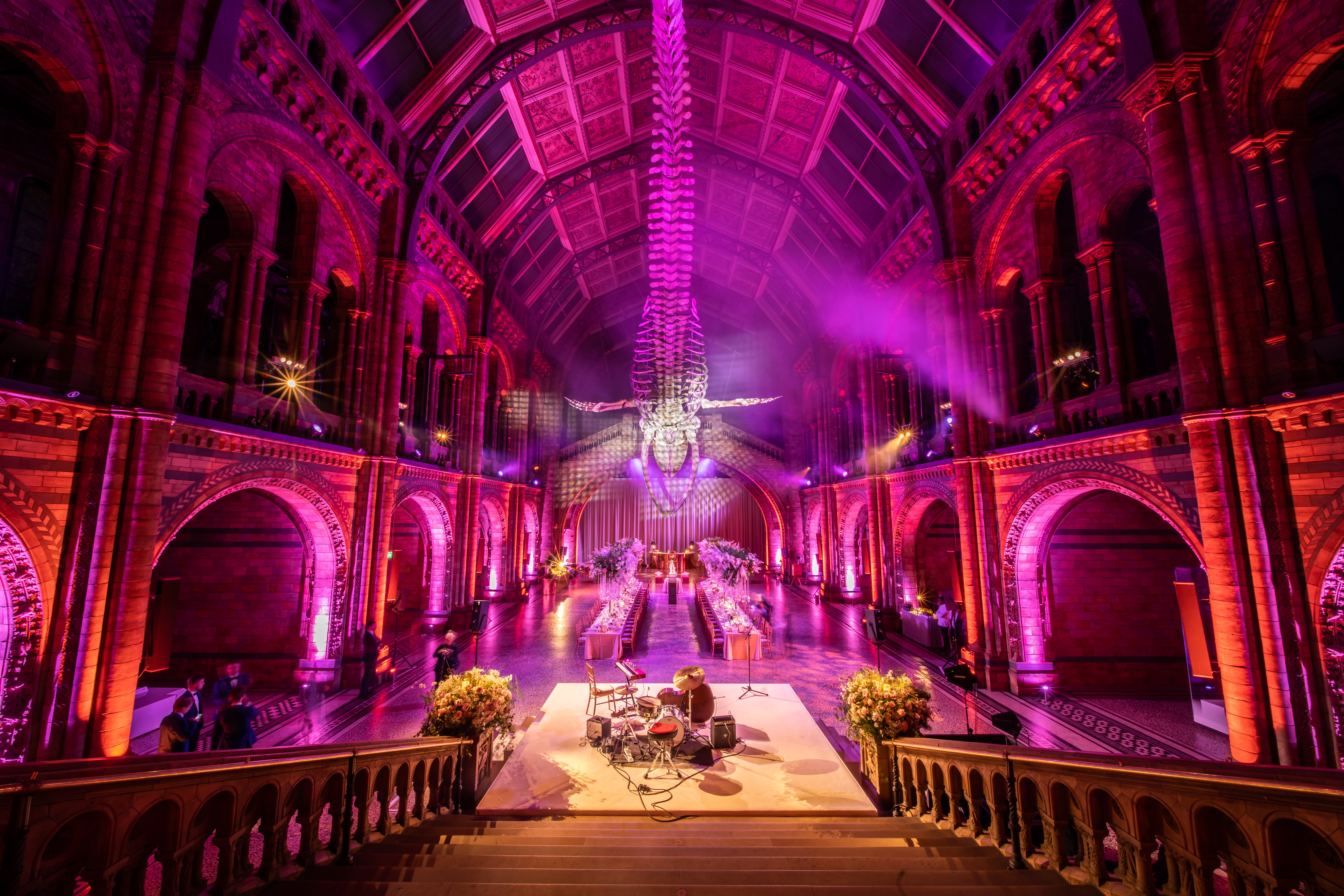 NHM wedding with dancefloor and banquet tables